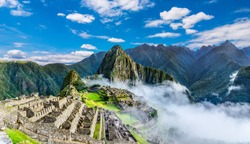Machu Picchu, Cusco region, Peru: Overview of agriculture terraces, Wayna Picchu and surrounding mountains in the background, UNESCO, World Heritage Site. One of the New Seven Wonders of the World