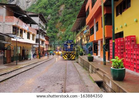 MACHU PICCHU PUEBLO, PERU - MAY 15: Train arrives to Machu Picchu pueblo station on May 15, 2013 in Machu Picchu pueblo, Peru.  #163884350