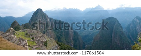 Machu Picchu with Huayna Picchu Behind It and Mount Putucusi to the right
