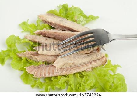 mackerel fillets on a white plate