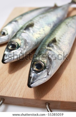 Mackerel on chopping board