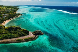 Maconde view point.Monument to captain Matthew Flinders in Mauritius. An unusual road to the Islands of Mauritius. Coral reef in the Indian ocean