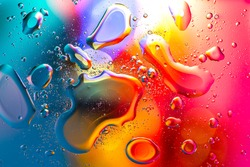 Macro abstract background of multicolored oil and water drops