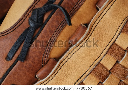 Macro abstract of leather baseball glove showing variety of textures and details.