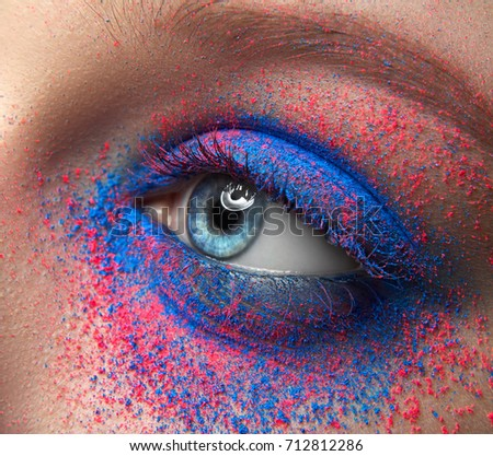 Macro and close-up creative make-up theme: beautiful female eyes with dry pink and blue pigment - Shutterstock ID 712812286