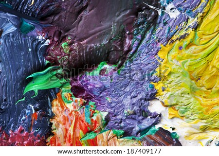 macro artist\'s palette, texture mixed oil paints in different colors and saturation studio