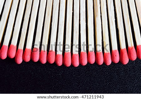 Macro background match sticks isolated on black #471211943