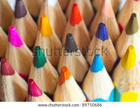 Macro background of the pencil as an element for design. Colored pencils closeup