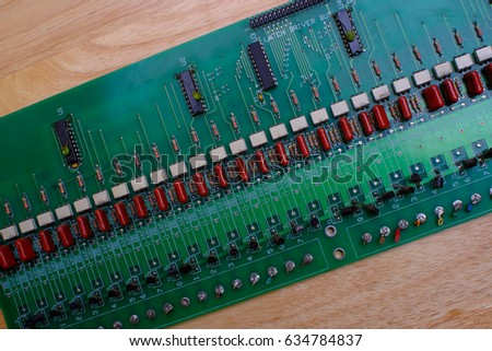Macro background shot of old green motherboard. Printed Circuit Board with many electrical components. #634784837