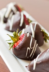 macro chocolate covered strawberries in a row, shallow depth of field focus on the second strawberry