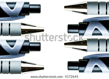 macro close up of  ball point pens isolated over white with copy space