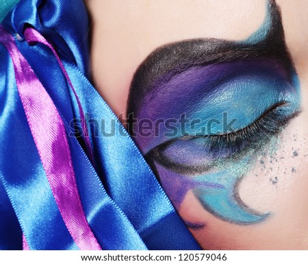 Macro close-up of beautiful female eye with bright creative make-up
