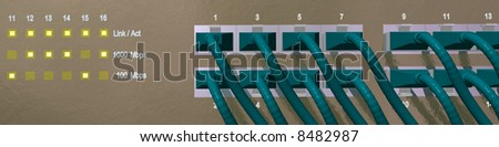 Macro/Close-up of ethernet cables connecting to a core router. - stock photo