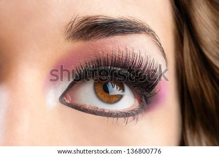 Macro close up of female eye with beauty make up. - stock photo