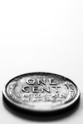Macro close-up of one cent us coin on white background with copy space black and white image