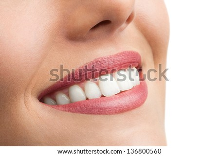 Macro close up of perfect female teeth isolated on white.