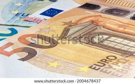 Macro close up on the design surface of 50 euro notes. Banknotes of the European Union. Wallpaper background of money. Detailed currency closeup. Euros isolated flat capture, New Fifty Euro Note Stockfoto ©