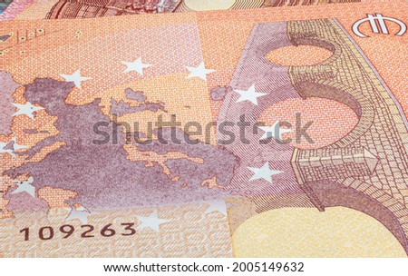 Macro close up on the design surface of 10 euro notes. Banknotes of the European Union. Wallpaper background of money. Detailed currency closeup. Euros isolated flat capture, New Ten Euro Note Stockfoto ©