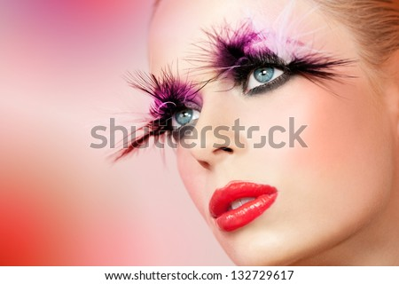 Macro close up portrait of female face with fantasy make up.