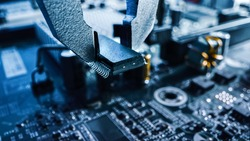 Macro Close-up Shot of Factory Machine at Work: Printed Circuit Board Being Assembled with Robotic Arm, Surface Mounted Technology Connecting Microchips, CPU Processor to the Motherboard.