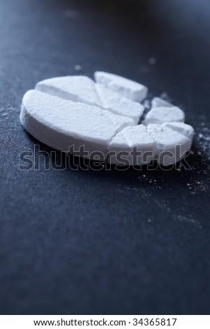Macro closeup of a soluble paracetamol tablet. Narrow depth of focus.
