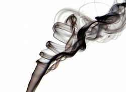 Macro closeup of black transparent  smoke floating into the air isolated on white background - Concept of toxic cigarette smell, chemical environment pollution, scented fragrance smell, dangerous gas