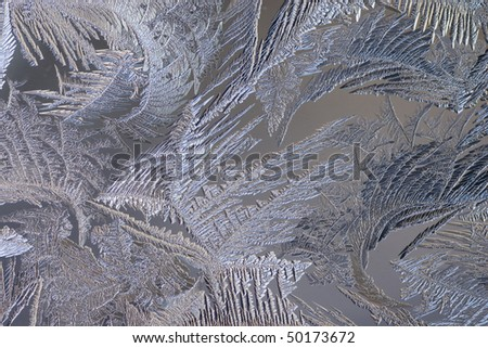 macro closeup of frost formations on a frozen window.