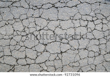 Macro closeup on concrete asphalt cracks on the road - stock photo