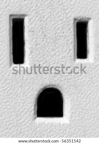 Macro closeup photograph of an American electricity outlet.