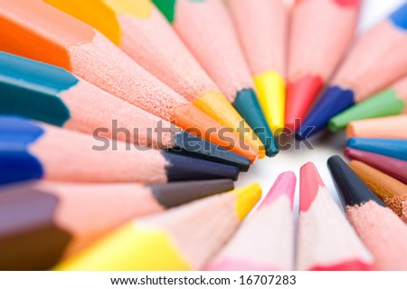 macro colorful crayons on white background