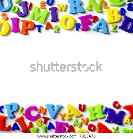 Macro composition of many colorful plastic toy letters