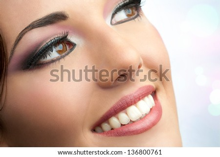 Macro cosmetic portrait of attractive young woman.