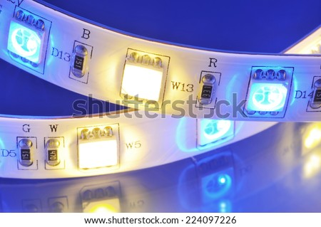 macro detail of a RGB-LED-stripe combined with warmwhite LEDs in colored spotlight #224097226
