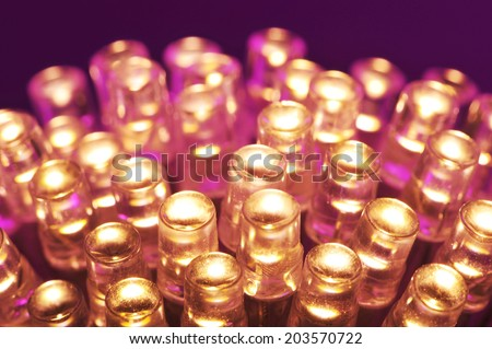 macro detail of some warmwhite LEDs in purple spotlight  #203570722