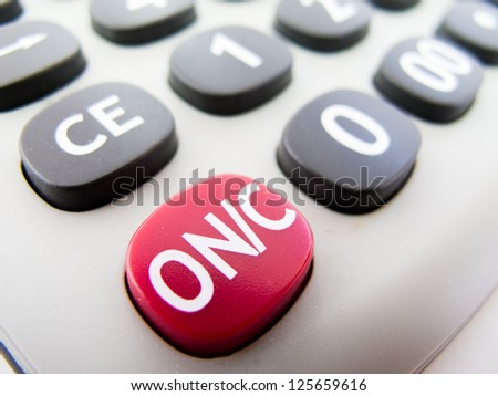 Macro detail of the ON button of a calculator