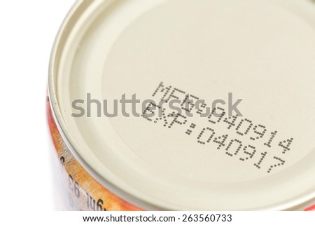 Macro expiration date on canned food isolated on white background