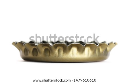 Macro golden bottle cap for beer isolated on white, side view  Сток-фото ©
