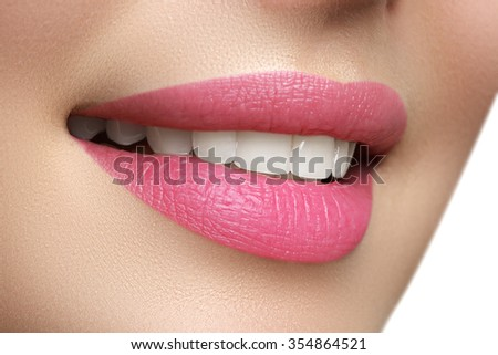 Macro happy woman\'s smile with healthy white teeth, bright pink .lips make-up. Stomatology and beauty care. Woman smiling with great teeth. Cheerful female smile with fresh clear skin