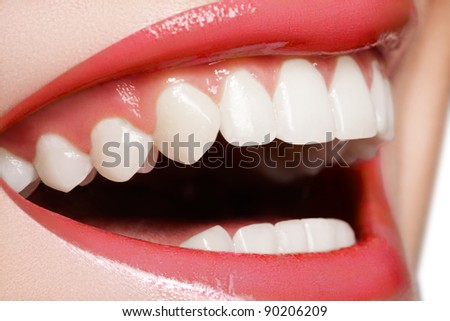 Macro happy woman's smile with healthy white teeth, bright red gloss lips make-up. Stomatology and beauty care