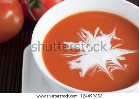 Macro image of a fresh tomato soup with cream