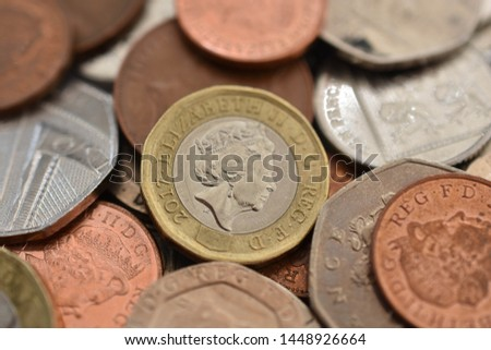 Macro image of British sterling with one pound coins in focus #1448926664
