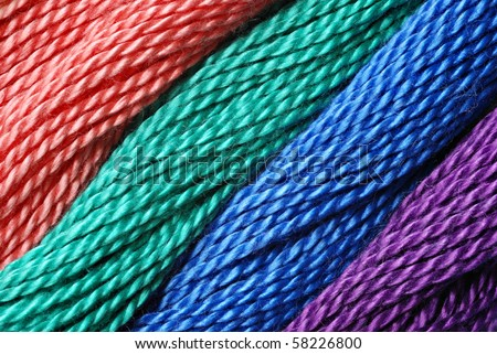 Macro image of colorful cotton craft thread with diagonal design.
