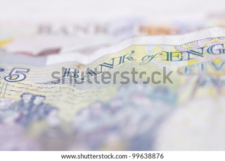 Macro image of English bank notes. Focus on ���£5 note.