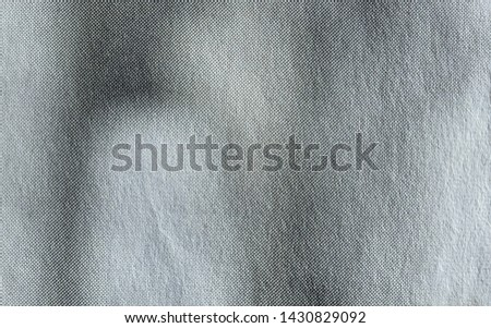 Macro image of grey halftone gradient dots on newsprint