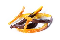 macro image of home made candied orange peel some pieces dipped in chocolate