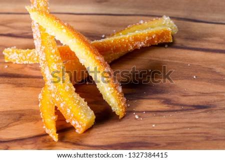 macro image of home made candied orange peel with large sugar granules