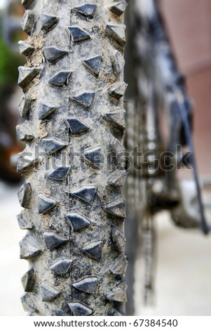Macro Image of Mountain Bike Tire and Shifter Assembly