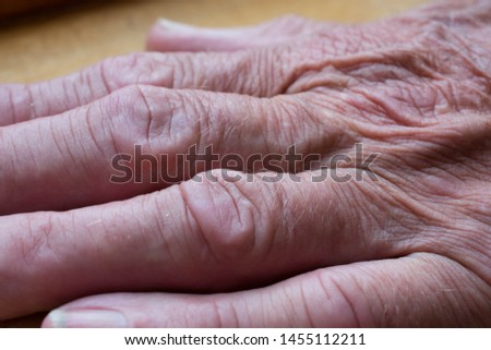 Macro image of old mans leathery wrinkly skin and fingers
