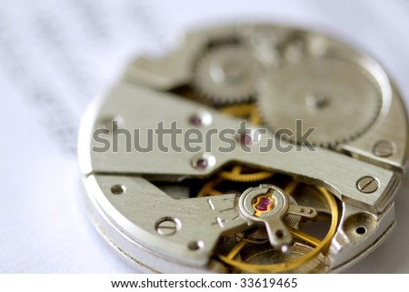Macro image of old watch mechanism on instructions sheet