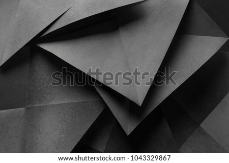 Macro image of paper folded in geometric shapes, three-dimensional effect, abstract background